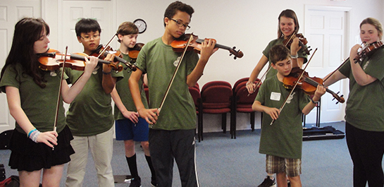 Violin students at summer camp