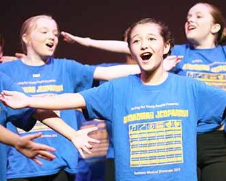 Students performing in the summer musical