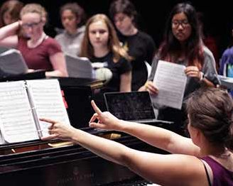 Students rehearsing in musical theater summer camp